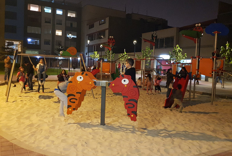 children playing at animal themed playground with tigers