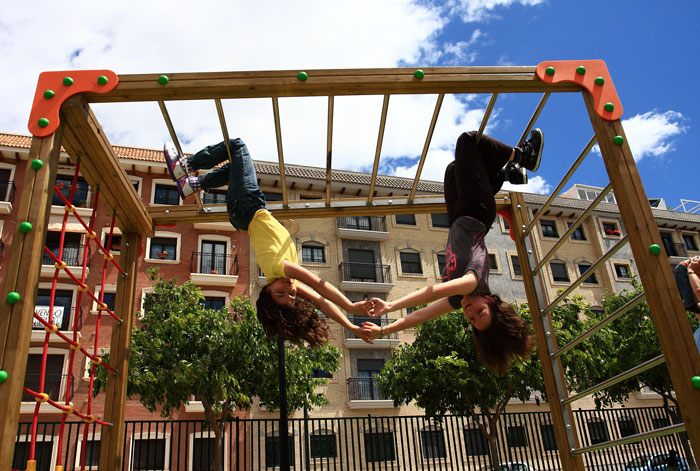 girls playing in a climbing structure at children's playgrounds