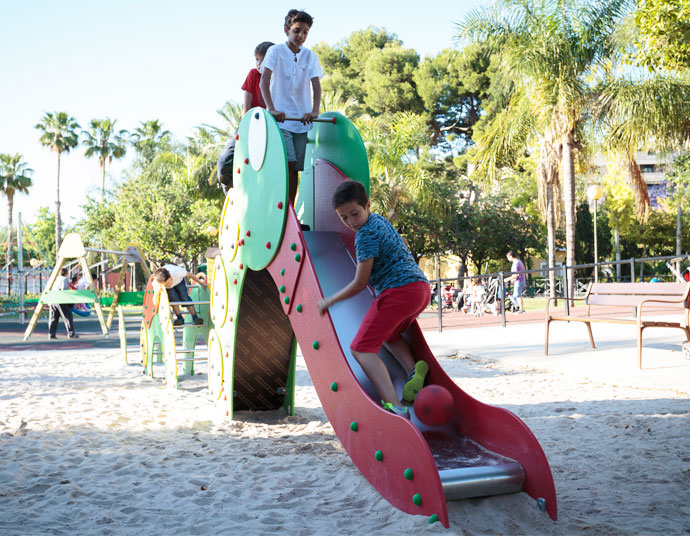 children playing with a slide which has the form of an animal