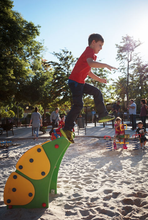 boy jumping in a children's playgrounds