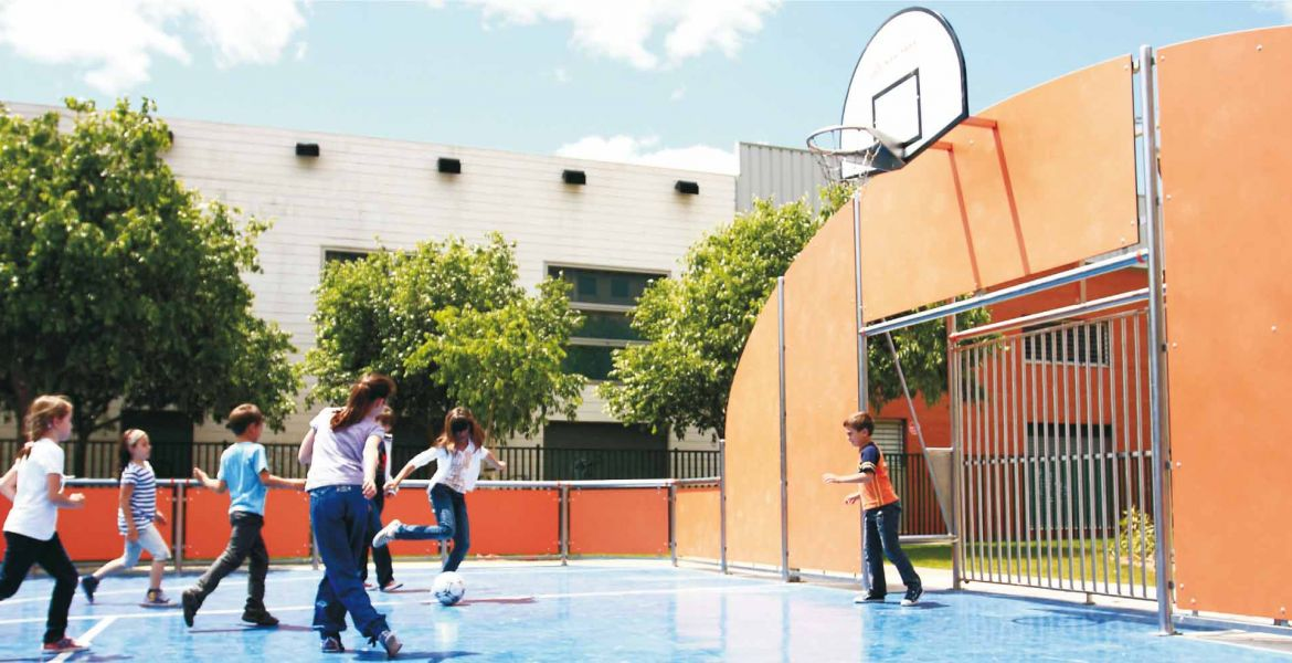 Multisport court with basket units and soccer goals