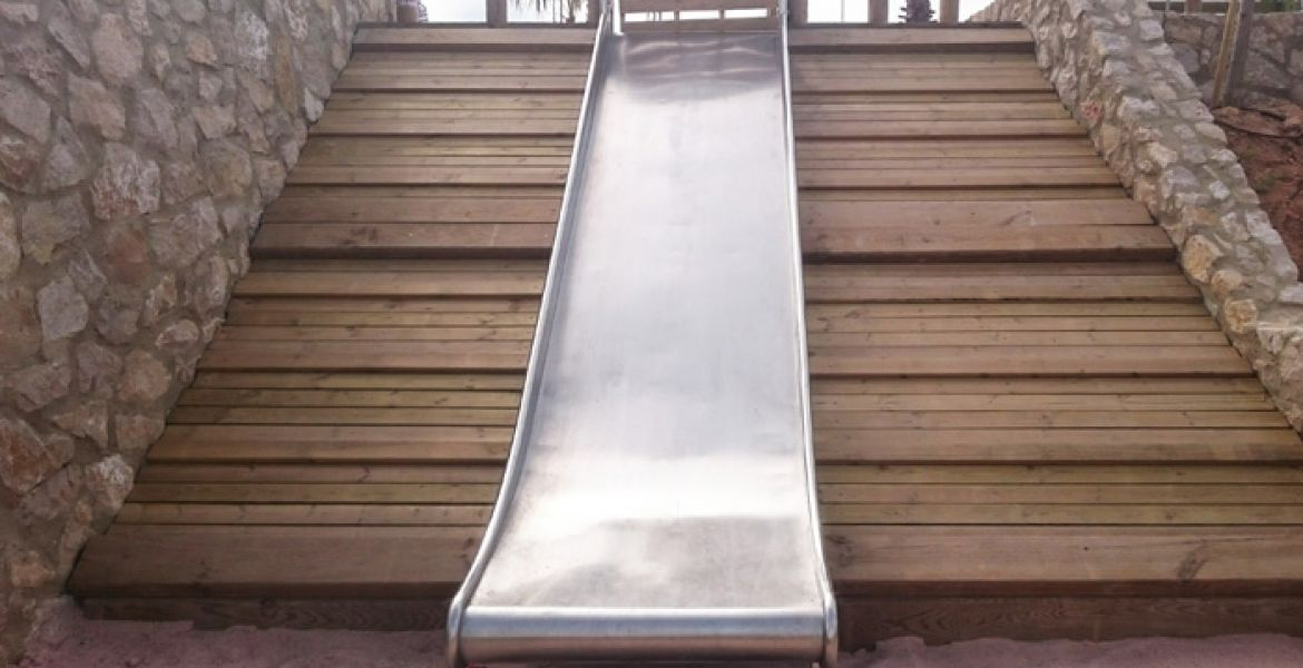 Stainless steel slide for embankment mounting on hill with wooden surfacing